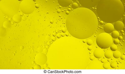 Background of oil drop in the water. - Yellow background of...