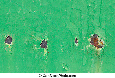 background of old cracked green paint with rust