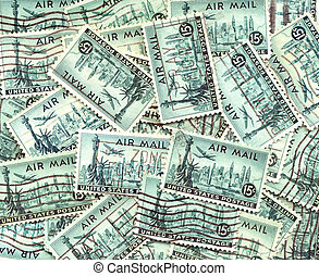 background of old U.S. air mail postage stamps