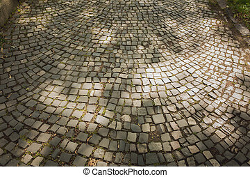 Background of paving stones at the street in light of sun