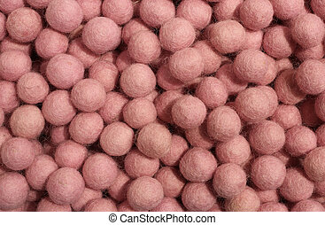 background of pink balls of wool