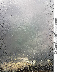 Background of rain drops on a glass