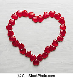 background of red hearts on a white wooden substrate