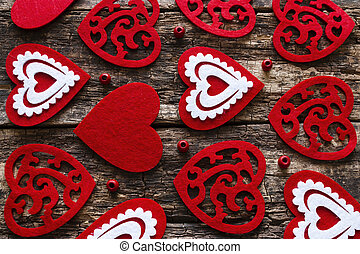 background of red hearts on a wooden background