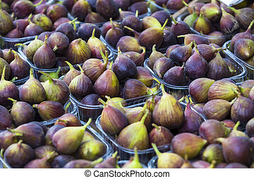Background of ripe juicy figs on the market stalls shot close-up