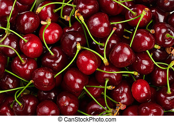 Background of ripe red cherries. Healthy eating. The texture of berries