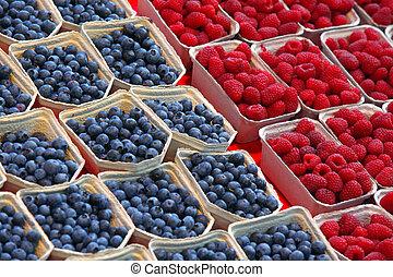 background of ripe red raspberries