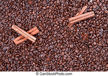 Background of roasted coffee beans with cinnamon sticks