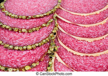 Background of slices salami with two various crust close-up