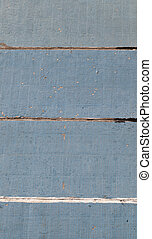 background of small ceramic tiles of blue color on a concrete wall of a multi-storey building, there is damage