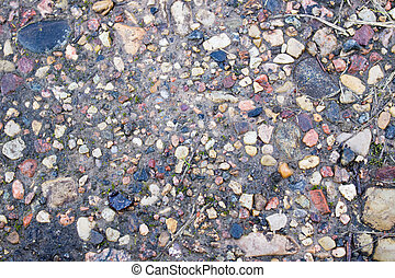 Background of small stones on the sand