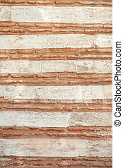 background of stone wall with red stripes, texture