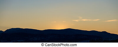 Background of sunset over mountains