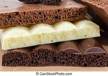 Background of texture of the various aerated chocolate...