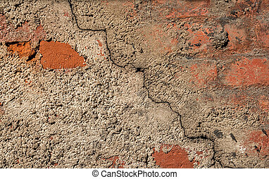 Background of the cement wall grey plain textured with a crack diagonally with elements of red brick.