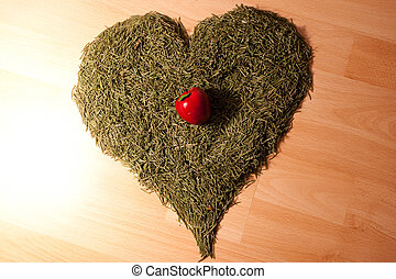 background of the Christmas tree needles in the shape of hearts and apples lying on the floor