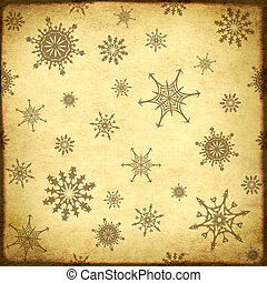 Background of the old, soiled paper and snowflakes pattern