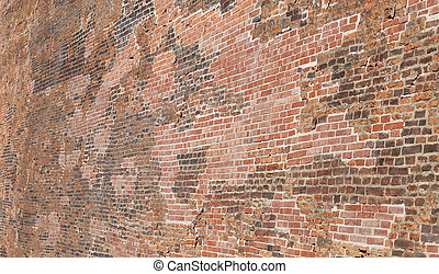 Background of thousands of red bricks of a large wall of an...