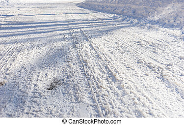 Background of tire tracks in snow