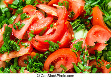 Background of tomato salad with green onions, black pepper and olive oil