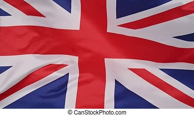 Background of UK flag waving in the wind - Close up full ...