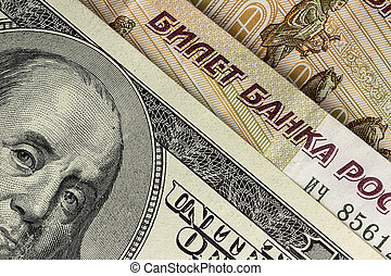 Background of US dollars and Russian rubles, close up