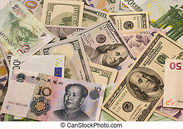 Background of various currency banknotes, dollar, euro, yuan.