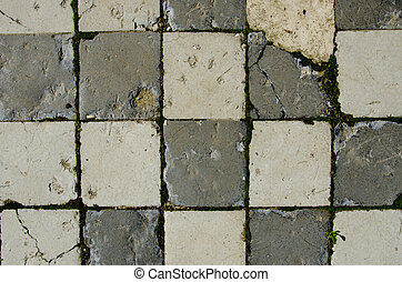 Background of white brick tiled old pavement moss