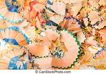 Background of wood shavings from grinding crayons