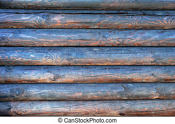 background of wooden natural logs of round brown color with tinted