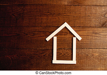 Background of wooden sticks in the form of a house