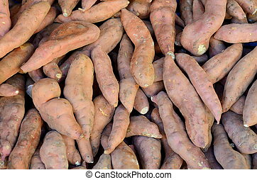 Background Of Yams At A Market