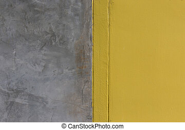 Background of yellow painted and cement wall