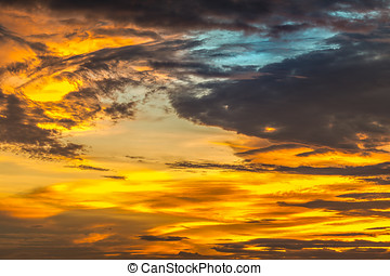 background of yellow sky with clouds at sunset