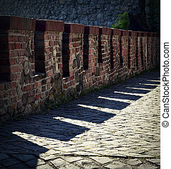 old defensive brick wall with shadow