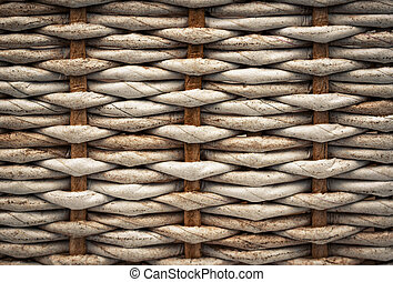 Detail of a braided basket with paper tubes