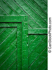 detail of a green wooden gates