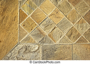 detail of cut sandstone tiles