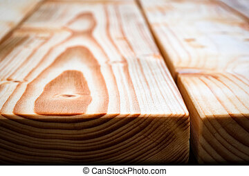 detail of wooden table edge