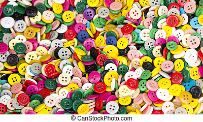 Background or texture of a pile of buttons of many colors and sizes