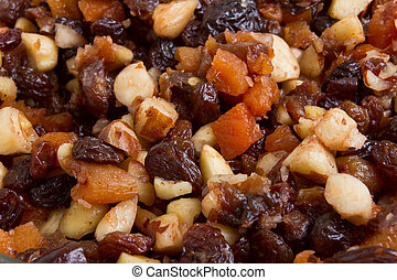 Background or texture of Xmas Cake Mix of nuts and soft fruits close up.