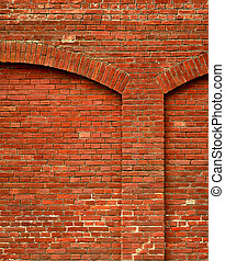 red brick wall with arch