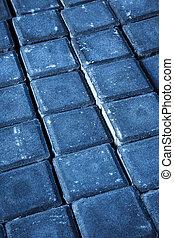 scuffed gray concrete cobblestones