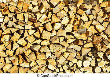 Background or texture symmetric with pieces of wood for stove fireplace