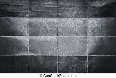 Background pattern of folded black paper in 16 parts