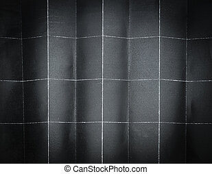Background pattern of folded black paper in 32 parts