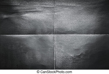 Background pattern of folded black paper in 4 parts