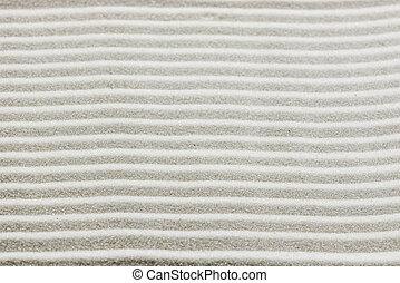 Background pattern of raked white sand