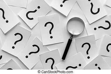 Background pattern of random question marks printed on white...