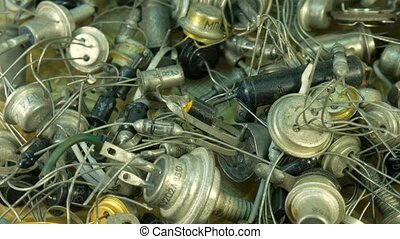 Background pile of old Radio components, diode end transistor with led bulbs.